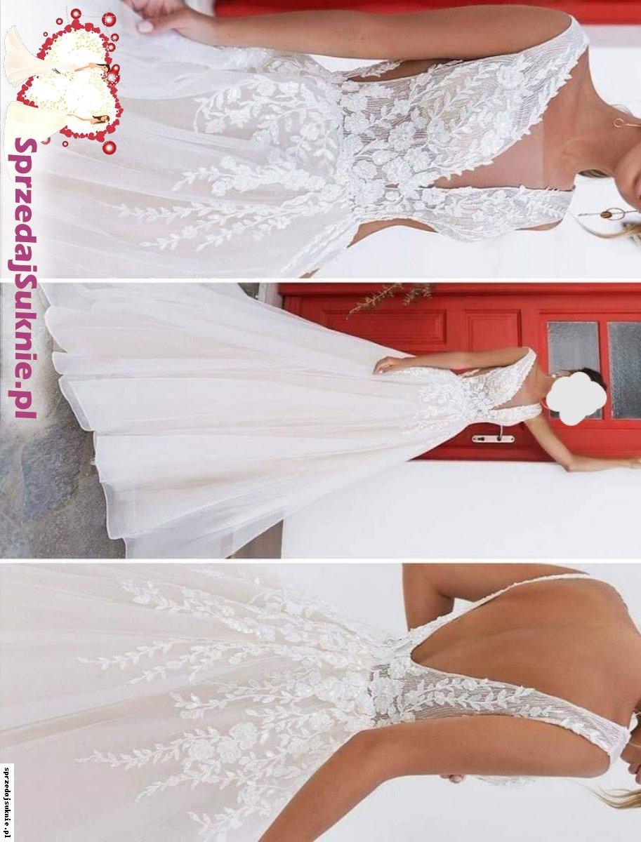 Efektowna suknia ślubna dodającą gracji i elegancji Pannie Młodej