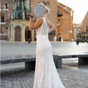 Sprzedam zjawiskową koronkową suknię w stylu włoskim z cekinami